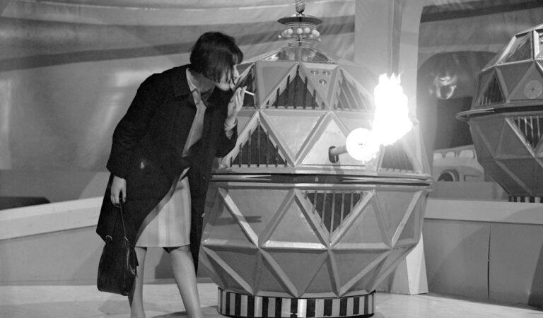 Doctor Who Producer Verity Lambert Lights Her Cigarette On A Mechonoids Flamethrower Between Shots (1 photo)