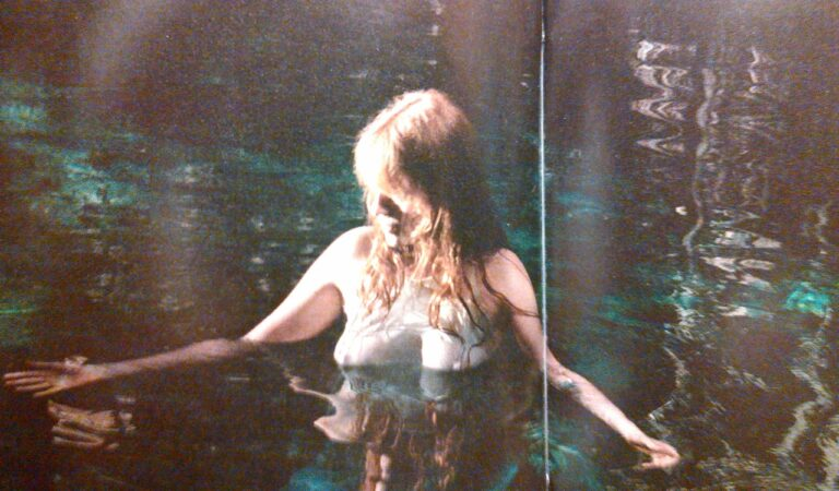 Florence Welch From Florence And The Machine Swimming In A Very Seethrough Shirt From The How Big How Blue How Beautiful Deluxe Cd Booklet (1 photo)